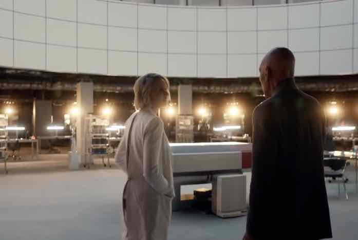 Dr. Agnes Jurati (Alison Pill) shows Picard around the Division of Advanced Synthetic Research at Daystrom. Courtesy of CBS All Access