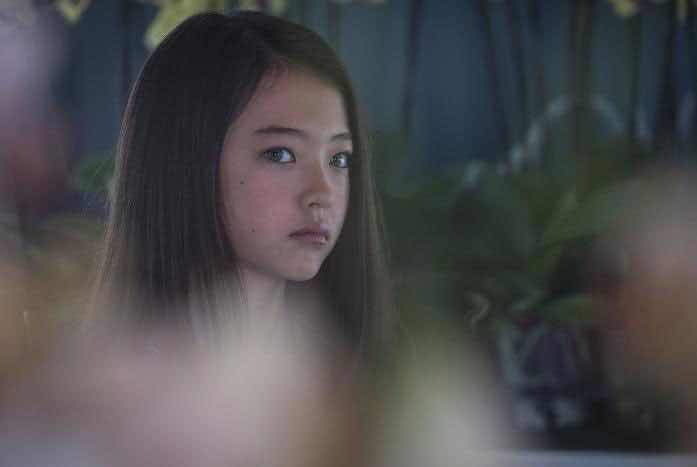Young Soji (Ella McKenzie) pokes through the forbidden lab of her father, Bruce Maddox. Courtesy of CBS