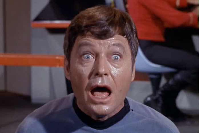 Dr. McCoy is shown here, full of cordrazene. The stuff makes you crazy and sweaty. Courtesy of CBS / Paramount