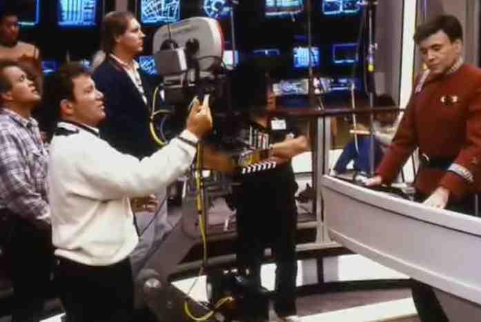 William Shatner directing Walter Koenig on the Enterprise bridge on Star Trek V.