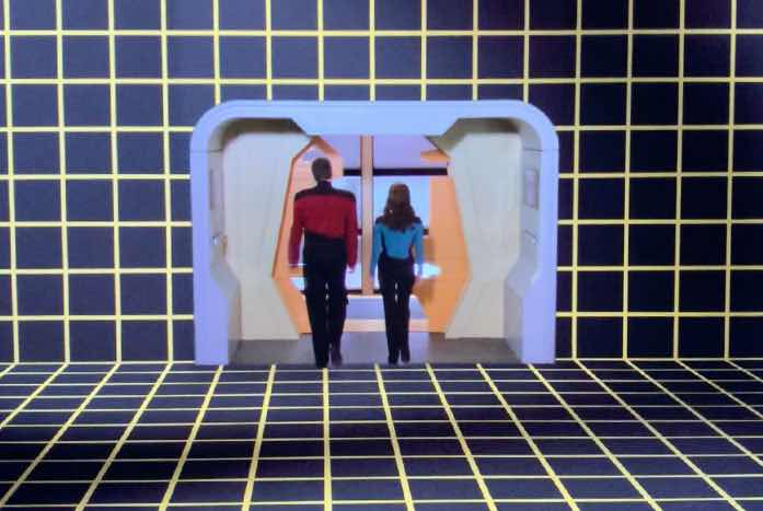 """Riker and Troi """"end"""" Enterprise, and exit the holodeck. Courtesy of CBS / Paramount"""