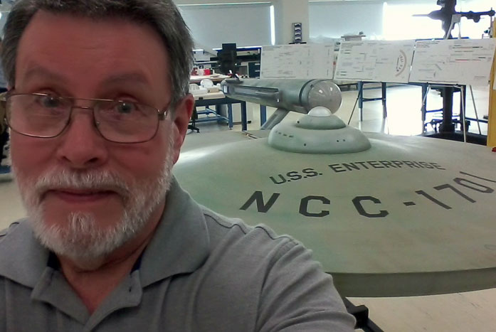 A selfie with the Enterprise. Probert was part of a team picked to restore the original Enterprise from the 1960s. Courtesy of Andrew Probert