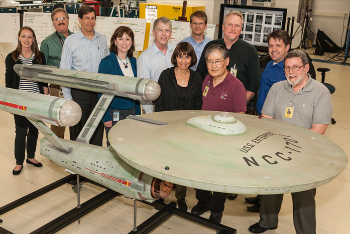 Probert (far right) and the team of Trek experts charged with restoring the 1960s Enterprise TV model in 2004. He was joined by Rick Sternbach, Adam Schneider, Dr. Margaret A. Weitekamp, Gary Kerr, Denise and Mike Okuda, John Goodson, and John Van Citters. Photo courtesy of Andrew Probert