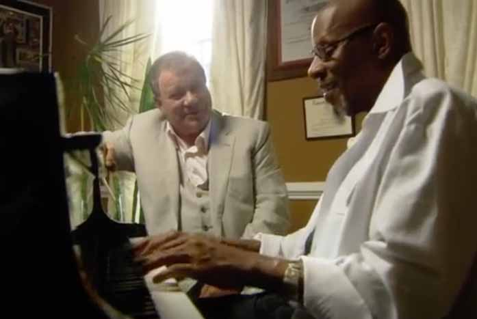 """Shatner and Avery Brooks share a touching moment on """"The Captains."""" Courtesy of 455 Films"""