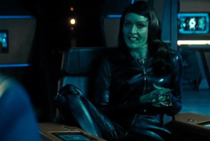 Osyraa's style of sitting in the Captain's Chair is even more awkward than Riker's. Courtesy of CBS