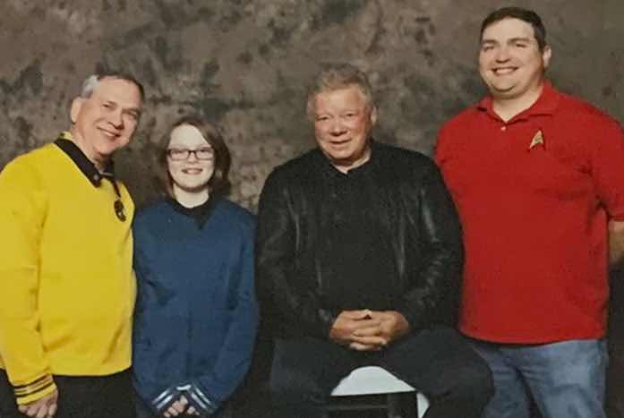 Mike Bovia (red) poses for a photo with William Shatner, along with Mike's father and daughter. Courtesy of Mike Bovia