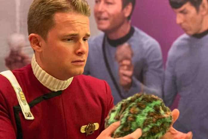 Tyler Habiger in his monster maroon inspecting a Tribble.
